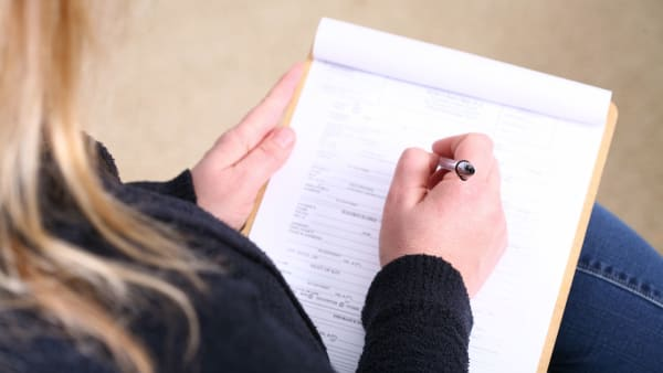 image of patient completing form